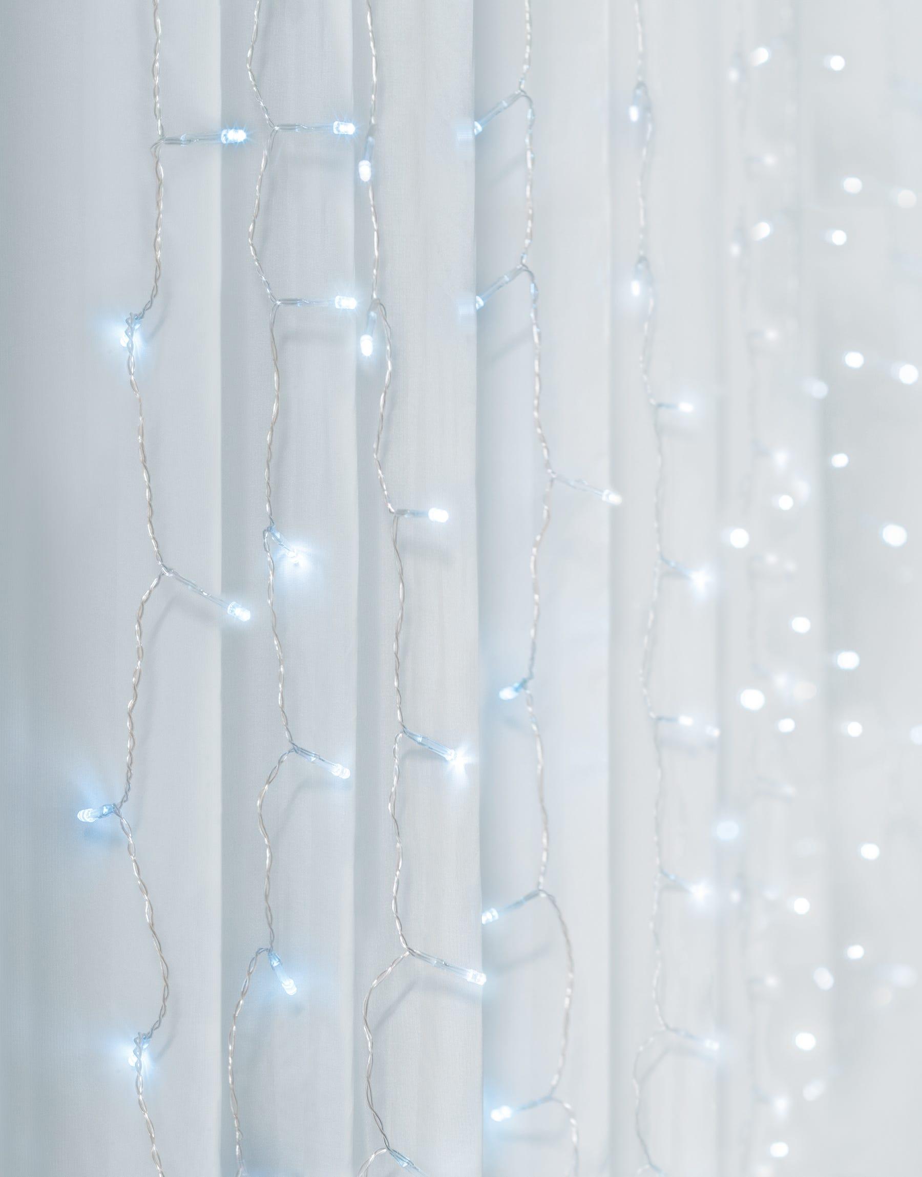 Cascada de luces LED para pared Merkury Innovations en blanco